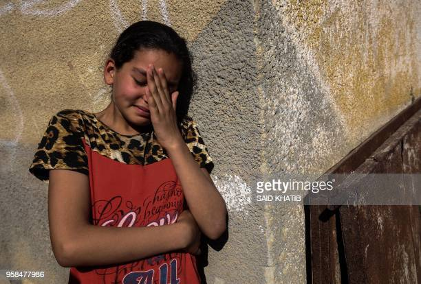 TOPSHOT A relative of Palestinian Mahmoud Abu Taima who was killed during a protest at the IsraelGaza border mourns during his funeral in Khan Yunis...