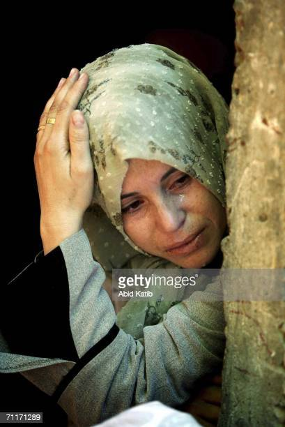 Relative of Palestinians who were killed by Israeli artillery fire on a crowded Gaza beach mourn during their funeral on June 10 2006 in Beit Lahia...