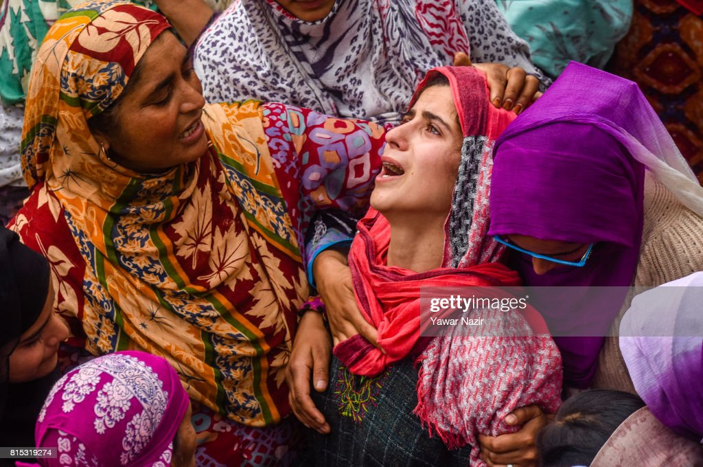 A relative of Parvaiz Ahmad Mir, a local rebel killed in a gun battle with Indian government forces, is consoled during his funeral on July 16, 2017 in Pohoo, 26km (16miles) south of Srinagar, the summer capital of Indian administered Kashmir, India. Thousands of mourners in Kashmir joined the funeral of the three rebels who were killed in a gunfight with government forces on Saturday. The day long gun battle started on Saturday on a hillock where the militants were taking shelter in a cave in the forest area of the Tral region in south Kashmir's Pulwom district, and ended yesterday evening. Indian government forces then launched a cordon and search operation, the militants hiding in a cave up the hill opened fire at the forces which retaliated, triggering a gun battle. Of the three militants killed in the gun battle, two were locals and had recently joined the militant outfit, and the third was a Pakistani national. The militants killed are believed to be members of Pakistan-based Jaish-e-Mohammad (JeM) militant outfit.