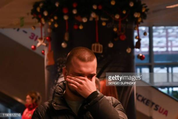 A relative of passengers and crew members of the crashed Ukraine International Airlines Flight PS752 reacts at the Boryspil airport outside Kiev on...