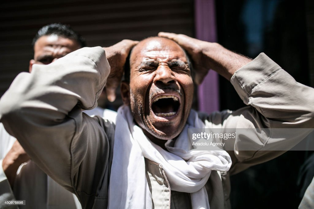 A relative of prisoners mourns after Egyptian court's death sentences about 183 Islamists in Minya, Cairo on June 21, 2014. An Egyptian court has confirmed death sentences for 183 Islamists including Mohammed Badie, Muslim Brotherhood Supreme Guide, accused of a 2013 attack on a police station.