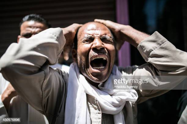 A relative of prisoners mourns after Egyptian court's death sentences about 183 Islamists in Minya Cairo on June 21 2014 An Egyptian court has...