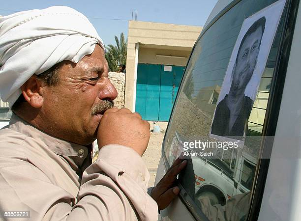 A relative of Reuters TV soundman Waleed Khaled cries as he looks at his picture during a funeral service on August 29 2005 in Baghdad Iraq A Reuters...