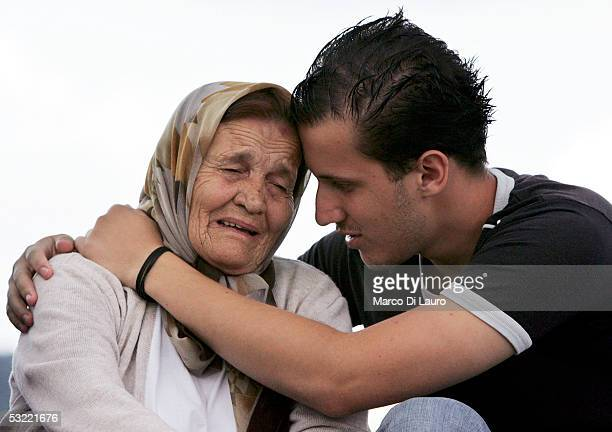 SREBRENICA BOSNIA HERZEGOVINA JULY 10 A relative of Srebrenica massacre victims cries while waiting for fellow travellers at the Srebrenica Memorial...