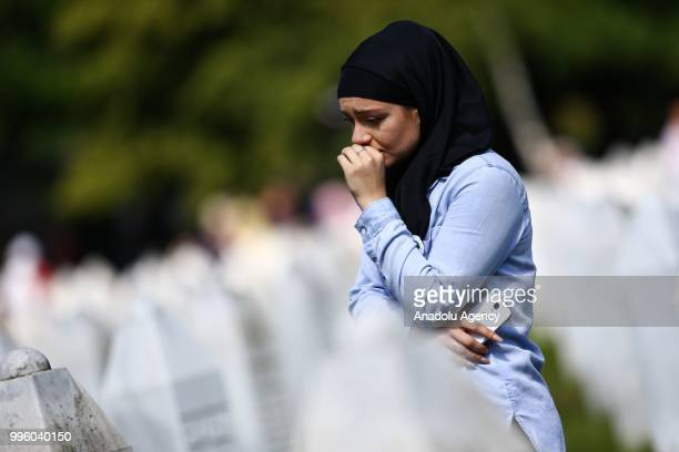 Relative of Srebrenica victim waits for burial of 35 victims at the Potocari Monument Cemetery in Srebrenica, Bosnia and Herzegovina on July 11,...