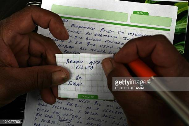 A relative of the Avalos brothers two of the 33 trapped miners writes a letter in the San Jose mine in Copiapo 800 km north of Santiago on September...