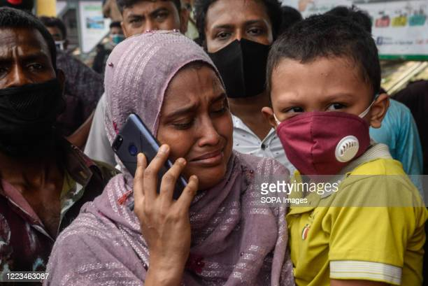 Relative of the deceased crying as a launch named 'Morning Bird' sank near the Farashganj ghat of Buringanga in Dhaka. A passenger vessel got hit by...