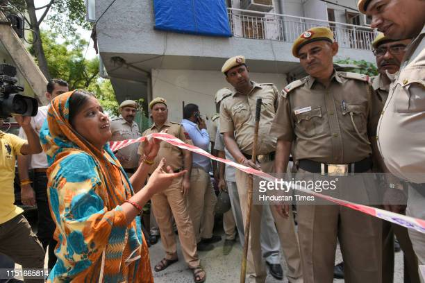 Relative of the elderly couple who were found murdered along with their domestic help, seeks permission from Police to enter the house, at Vasant...