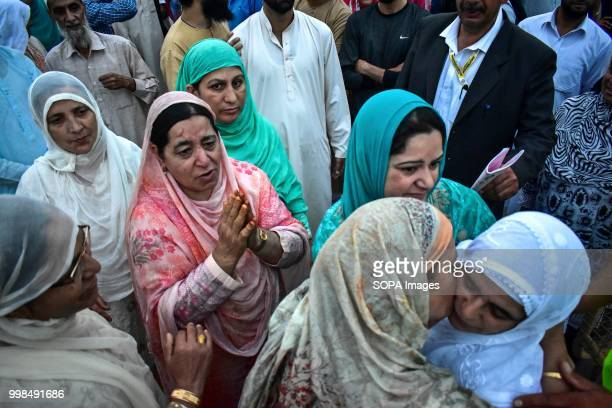 A relative of the Kashmiri Muslim pilgrim prays as she leaves for the annual hajj pilgrimage to the holy city of Mecca in Srinagar Indian...