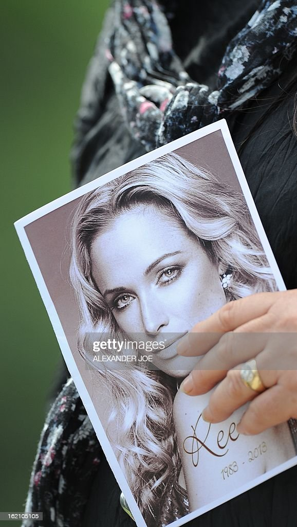 A relative of the late South African model Reeva Steenkamp holds the funeral ceremony program at the crematorium building in Port Elizabeth on February 19, 2013 after Steenkamp, 29, was shot four times in the early hours of February 14, 2013 by a 9mm pistol owned by South African sporting hero Oscar Pistorius. South African prosecutors on Tuesday told a bail hearing that Oscar Pistorius was guilty of 'premeditated murder' in the Valentine's Day killing of his model girlfriend at his upscale home.
