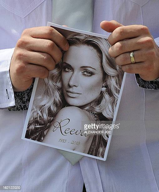 A relative of the late South African model Reeva Steenkamp holds the funeral ceremony program at the crematorium building in Port Elizabeth on...