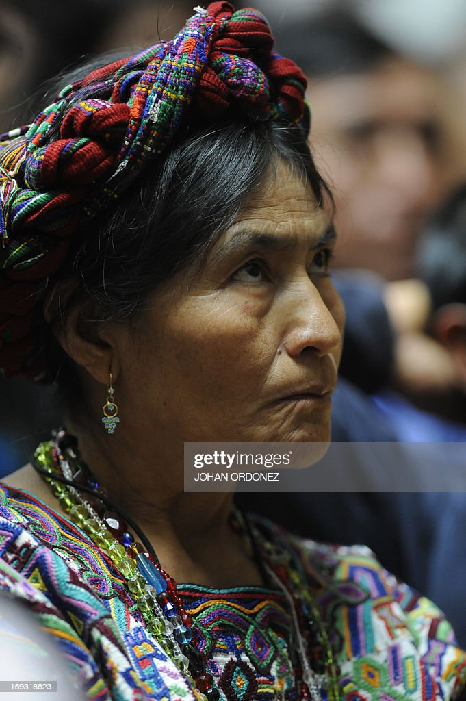 A relative of victims of the slaugther of the villa Dos Erres is seen in a hearing at the Supreme Court of Justice in Guatemala City on January 11, 2013, in which relatives requested that an amnesty application for Guatemalan former de facto president (1982-1983) and retired General, Jose Efrain Rios Montt, who is facing genocide charges for abuses committed during his military dictatorship, be rejected. The case involves the massacre of 201 peasant farmers in the village of Dos Erres during a military operation December 6-8, 1982 in Peten, 600 km north of Guatemala City. AFP PHOTO/Johan ORDONEZ