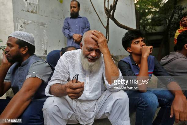 A relative of victims who were killed in a fire mourns in Dhaka on February 21 2019 At least 70 people were killed on February 20 2019 when a massive...