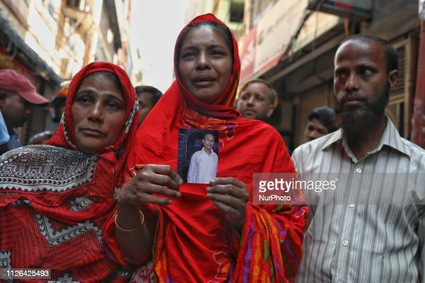 A relative of victims who were killed in a fire mourns in Dhaka on February 21 2019 At least 69 people have died in a huge blaze that tore through...