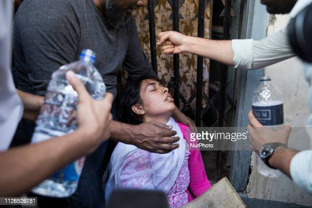 A relative of victims who were killed in a fire mourns in Dhaka on February 21 2019 At least 81 people have died in a huge blaze that tore through...