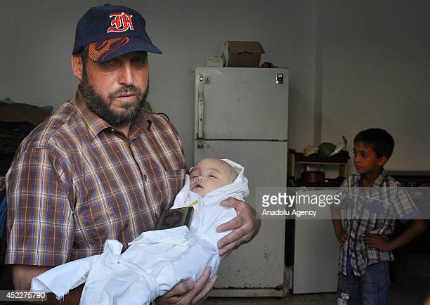Relative of youngest victim of airstrikes of Israel, 5 month baby Lema mourns for Lema in Gaza city, Gaza on 16 July, 2014.