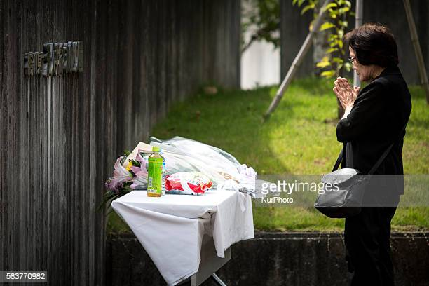 A relative pay respect after offering a flower for the victim in front of the entrance of Tsukui Yamayurien building at Sagamihara on Wednesday July...