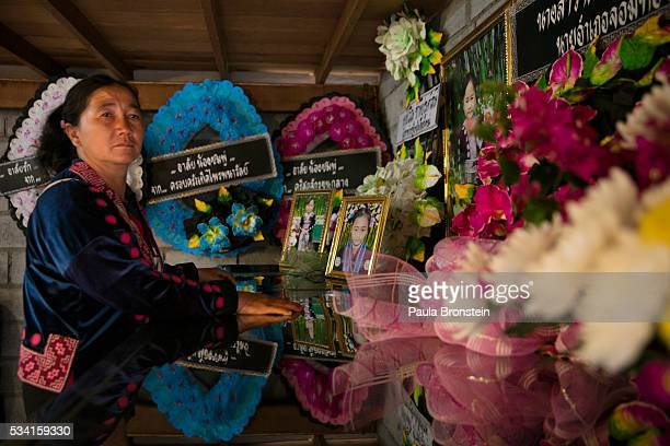 A relative pays her respects during a memorial service in the Hmong community of Jom Thong Chiang Mai province May 25 2016 A tragic fire broke out on...