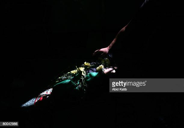 A relative puts flowers on the body of fivemonth old Mohammad Naser AlBuri as he lies at the mosque during his funeral February 28 2008 in Gaza City...