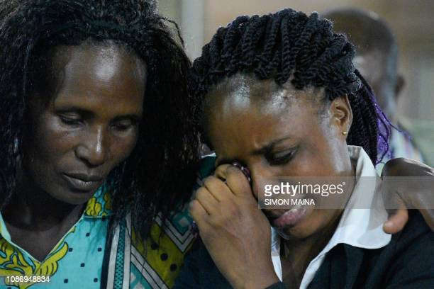 A relative reacts as she attends a memorial service on January 23 in Nairobi for six staff members of the Dusit hotel and office complex who were...