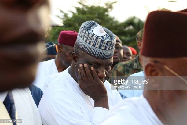 A relative reacts during the funerals of two Air Force pilots killed in a fighter jet crash in Abuja on September 28 2018 during their funerals...