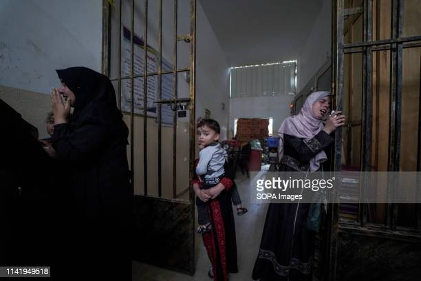 A relative seen mourning during the funeral of Maria alGazali a fourmonthold Palestinian baby who was martyred in an Israeli raid that hit her house...