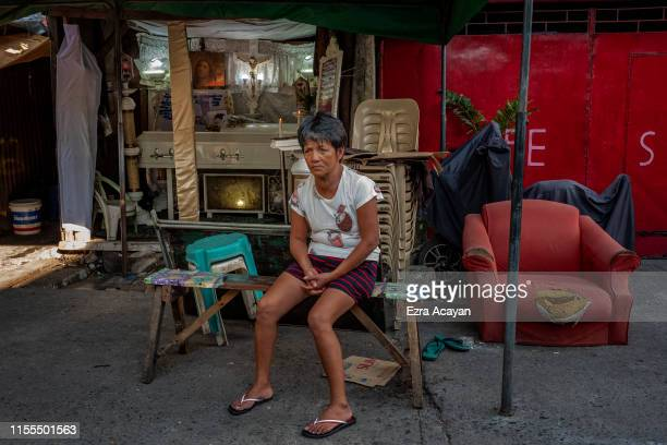 A relative sits outside the funeral wake of John Ryan Marquez on July 13 2019 in Malabon Metro Manila Philippines According to police Marquez was...
