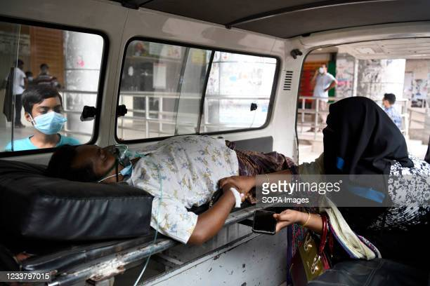 Relative transports a Covid-19 patient to Dhaka Medical College Hospital for admission to get treatment during the coronavirus pandemic in Dhaka.