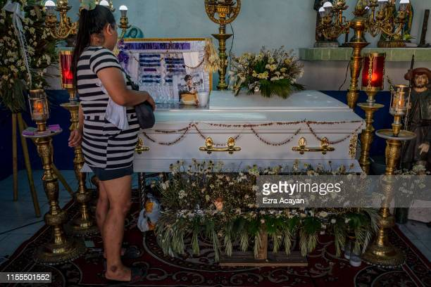 A relative views the coffin of Ricky Adarayan on July 13 2019 in Malabon Metro Manila Philippines According to relatives say Adarayan was abducted...