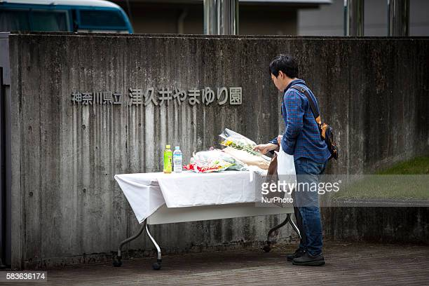 A relative visit to offer a flower for the victim in front of the entrance of Tsukui Yamayurien building at Sagamihara on Wednesday July 27 2016 in...