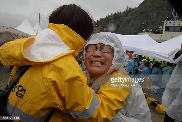 A relative weeps as she waits for missing passengers of a sunken ferry at Jindo port on April 17 2014 in Jindogun South Korea At least six people are...