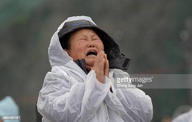 A relative weeps as she waits for missing passengers of a sunken ferry at Jindo port on April 18 2014 in Jindogun South Korea At least twenty eight...