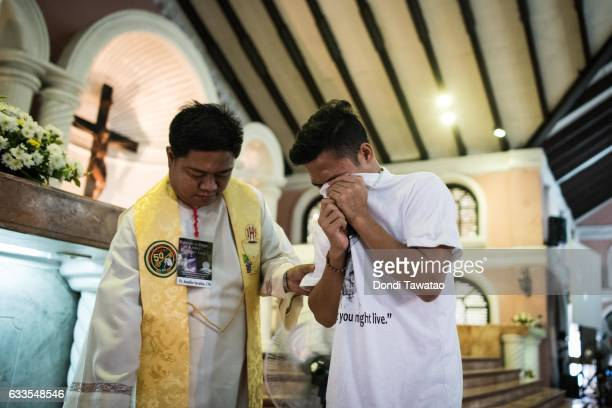 A relative weeps during a mass held for victims of the drug war on February 2 2017 in Manila Philippines Philippine president Rodrigo Duterte said he...