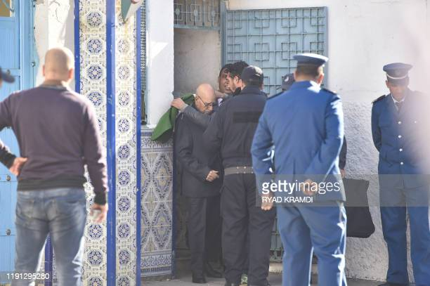 Relative wraps Algerian war veteran Lakhdar Bouregaa with a national flag upon his release in Algiers on January 2 after his arrest last summer...