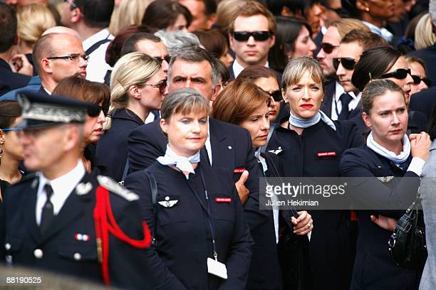 Relatives and Air France flight personnel react outside the Notre Dame Cathedral where they attend the ecumenical service in memory of the victims of...
