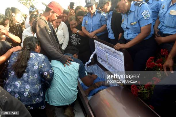 Relatives and colleagues of Nicaragua's policewoman Juana Francisca Aguilar, who died after being injured during clashes in protests against the...