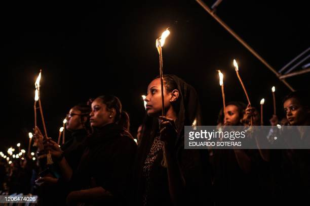 Relatives and colleagues of the Ethiopian Airlines' crew victims hold candles during a commemoration ceremony held by the Airline Pilots' Association...