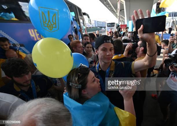 Relatives and fans greet players as Ukraine's U20 national football team arrives at Kiev's Boryspil Airport on June 16 2019 Ukraine won the FIFA U20...