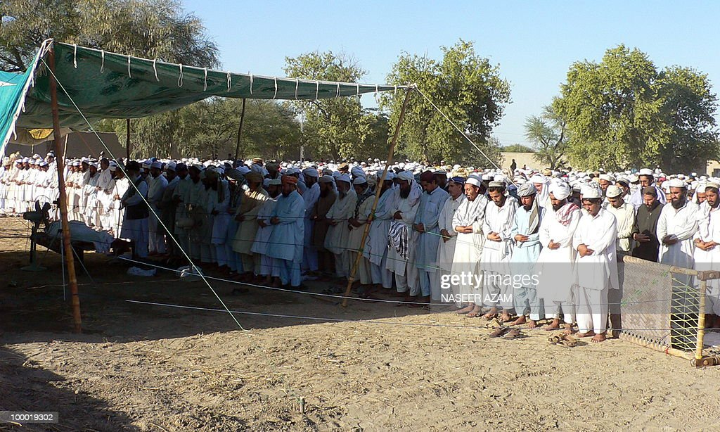 Relatives and followers of a Pakistani cleric Maulana Mirajuddin, offer funeral prayers in front of his coffin at Gomal village, near Tank town on May 20, 2010. Gunmen in northwest Pakistan on May 20 shot dead Mirajuddin a former pro-Taliban lawmaker who was instrumental in brokering several peace deals between the government and Islamist militants, officials said. The killing took place in a village near Tank town, which borders South Waziristan -- the tribal district where the military last October launched an air and ground offensive to flush out Taliban militants.