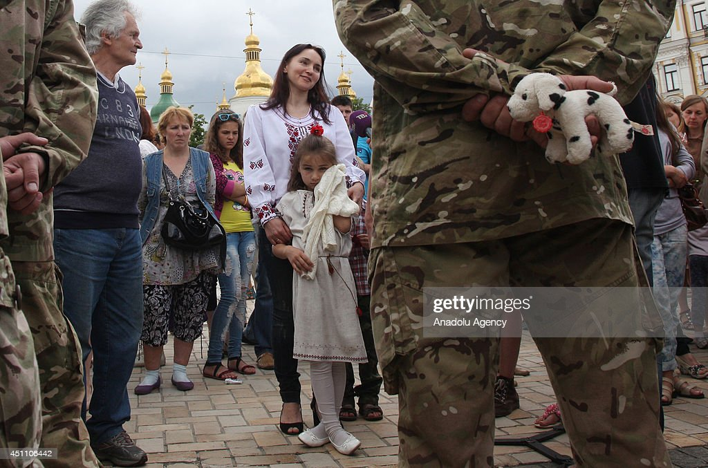 Relatives and friends attend allegiance ceremony of Ukrainian army battalion 'Azov' before they departing to eastern Ukraine, in Kiev, Ukraine on June 23, 2014.