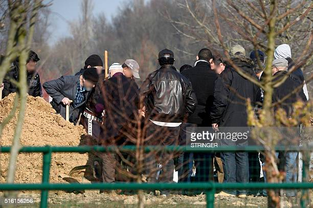 Relatives and friends attend the burial ceremony of Brahim Abdeslam one of the attackers of the November 13 Paris attacks at the interdenominational...