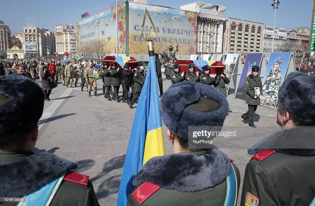 Relatives and friends attend the funeral ceremony of the Aidar battalion servicemen Vadim Shalatovsky (31) and Nazar Yakubovsky (17), who were killed in the eastern Ukraine conflict, at the Independence Square in Kiev, Ukraine, 25 March 2015.