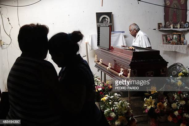 Relatives and friends attend the wake of vigilante group leader Miguel Angel Jimenez Blanco in Xaltianguis Guerrero State Mexico on August 9 2015 The...