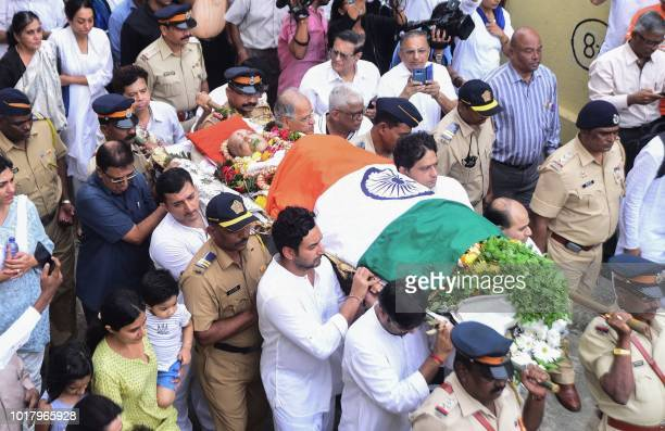 Relatives and friends carry the body of former cricketer Ajit Wadekar to a crematorium in Mumbai on August 17 2018 Former Indian cricket captain Ajit...