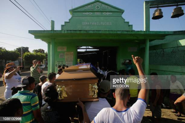 Relatives and friends carry the coffin of Bismark Martinez who died in hospital three months after being injured during antigovernment protests to...