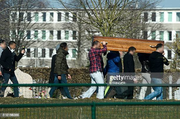 Relatives and friends carry the coffin of Brahim Abdeslam one of the attackers of the November 13 Paris attacks during his burial ceremony at the...