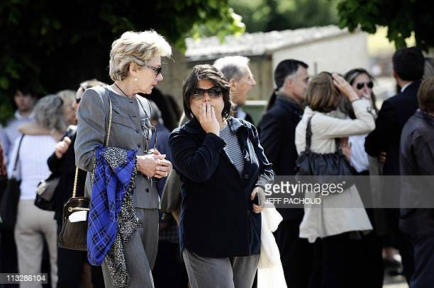 Relatives and friends come out of the cemetery in NoyerssurSerein southern of Paris on April 30 after the burial service of the Dupont de Ligonnes...