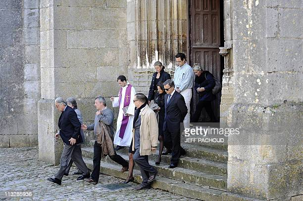 Relatives and friends come out of the church of NotreDame in NoyerssurSerein southern of Paris on April 30 after the private funeral ceremony of the...