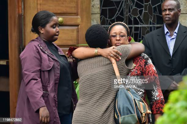 Relatives and friends consoles a family member outside the Lee Funeral Home following the death of former Kenya's president Daniel Arap Moi in...