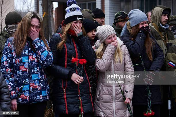 Relatives and friends cry during the funerals of four rebel fighters on February 16 2015 in Donetsk Ukraine The rebels died on the frontline in...
